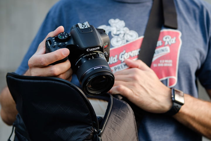 Product photo of Canon EOS Rebel T8i being taken out of camera bag.